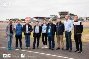 Le Mans - Officials and drivers from each class embark on an inspection lap of the circuit